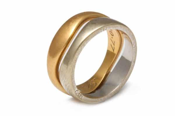 "cartier two color 18k ""love"" stacked rings"