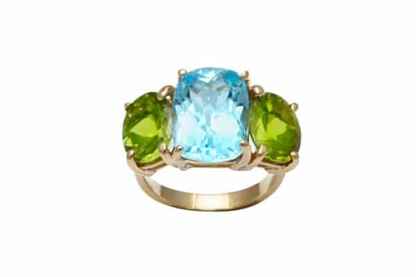 three stone peridot & topaz ring