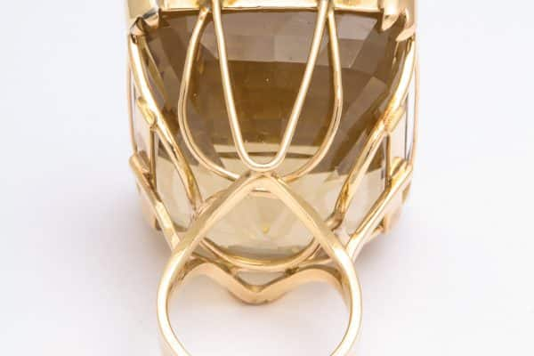 Large emerald cut cocktail ring